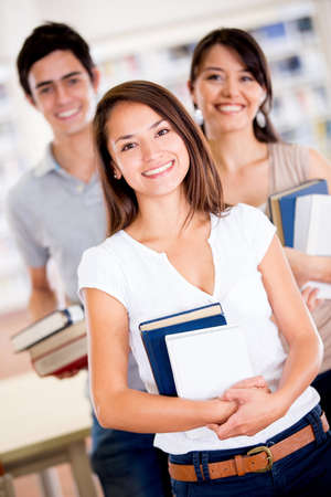 Group of university students at the library smiling Stock Photo - 16586967