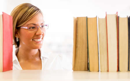 Woman at the library looking for a book Stock Photo - 16586963