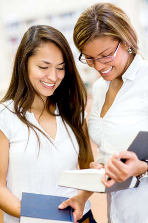 Female students at the library researching  and looking happy Stock Photo - 16586870
