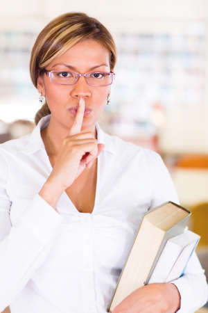 Female student asking to keep quiet at the library Stock Photo - 16586955