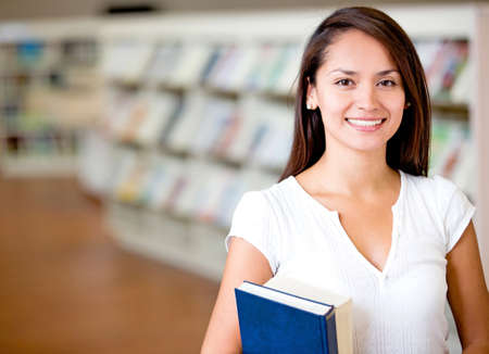Female student at the library looking happy photo