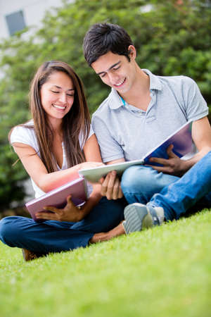 Couple of students outdoors looking very happy Stock Photo - 16586883