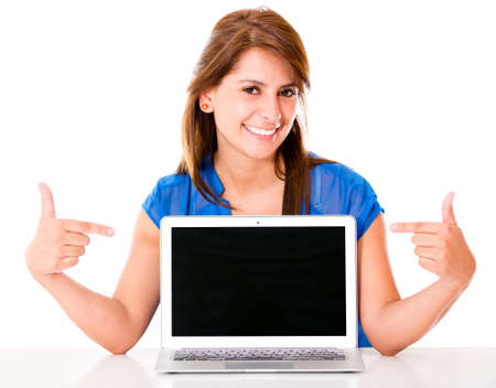 Woman pointing at a laptop computer - isolated over white Stock Photo - 16586891