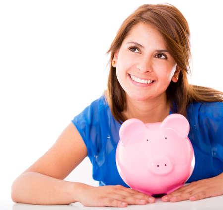 coinbank: Mujer pensativa con sus ahorros - aislados en un fondo blanco Foto de archivo