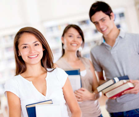 Group of college students at the library Stock Photo - 16586888