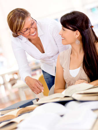 Teacher helping a student at the university Stock Photo - 16587225