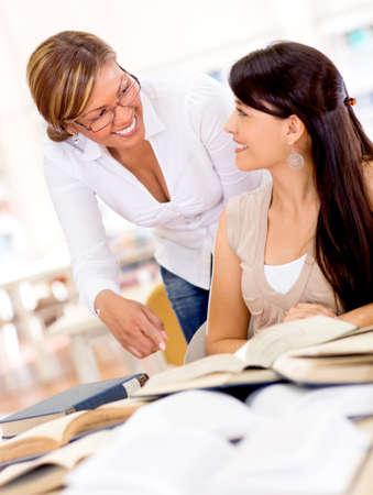advisor: Teacher helping a student at the university