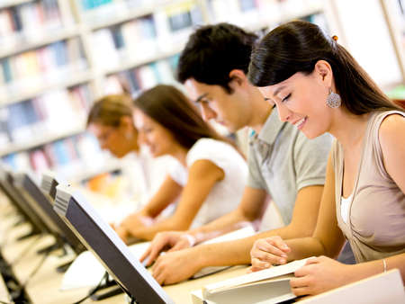 Group university ICT students using computers and smiling Stock Photo - 16586958