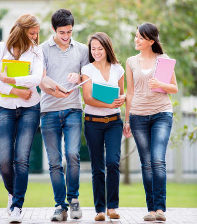 Group of casual students talking and looking very happy photo