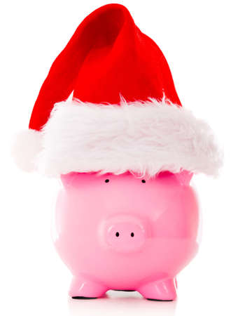 christmas savings: Christmas savings with a piggybank wearing a Santa hat - isolated over white Stock Photo