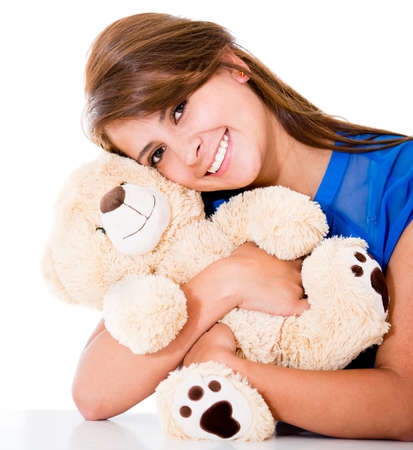 Sweet woman with a teddy bear - isolated over a white background Stock Photo - 16691545