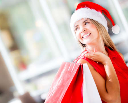 Beautiful happy woman doing her Christmas shopping Stock Photo - 16691537