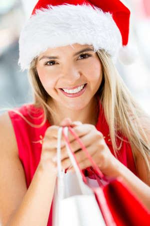 Beautiful female Santa on a shopping spree Stock Photo - 16691535