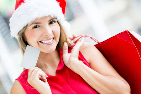 Woman shopping for Christmas with a credit card photo