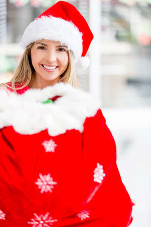 Female Santa with a gift sack at the shopping center photo