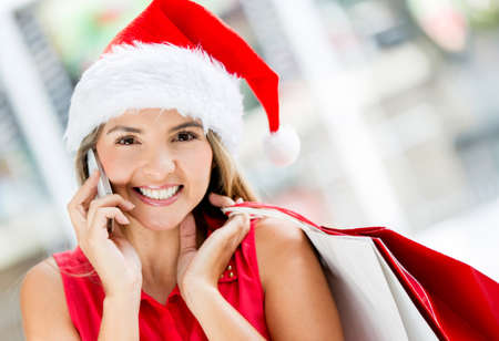 Christmas female shopper talking on the phone Stock Photo - 16691544
