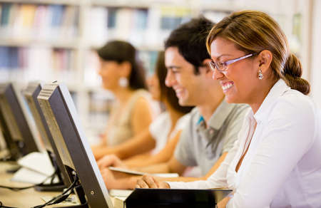 Students researching online at the library on computers photo