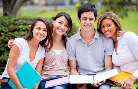 college campus: Group of university students outdoors looking happy