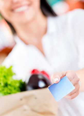Woman paying by credit card at the supermarket photo