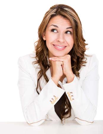frau denken: Thoughtful business woman looking up - isoliert �ber einen wei�en Hintergrund