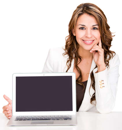 Businesswoman showing a laptop screen - isolated over a white background photo