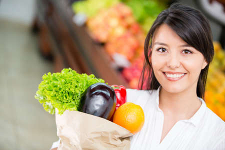 Latin woman shopping for groceries at the marketplace Stock Photo - 16711112