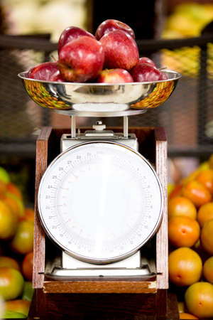 Apples on a weight scale at the supermarket Stock Photo - 16712504