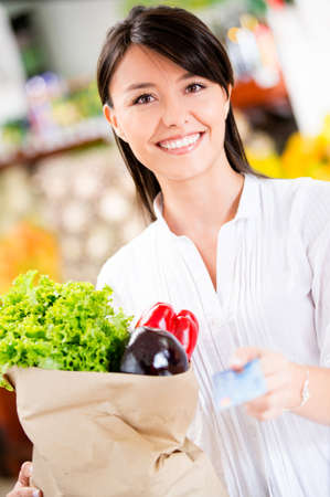 Female customer paying by credit card at the supermarket Stock Photo - 16711106