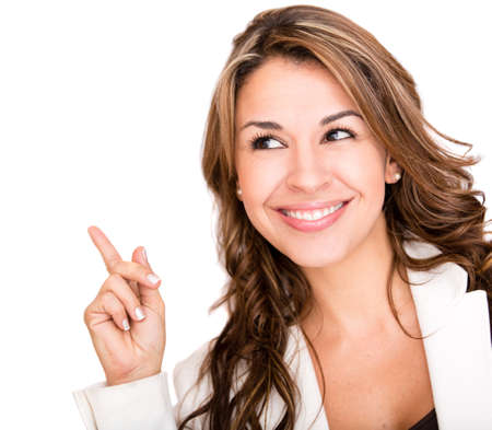 Happy business woman pointing an idea - isolated over white photo