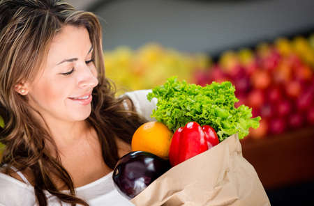 Woman buying vegetables at the local store Stock Photo - 16711131