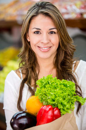 Healthy female shopping buying fresh groceries photo