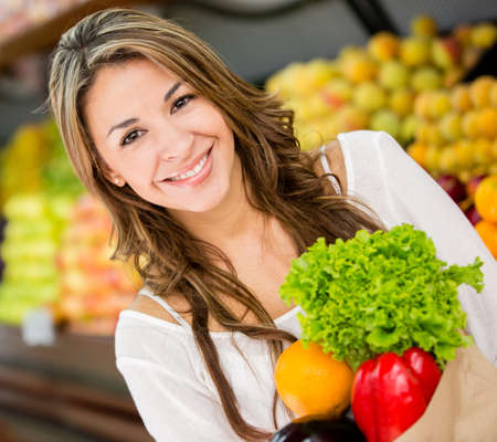 Beautiful woman buying groceries at the supermarket Stock Photo - 16711107