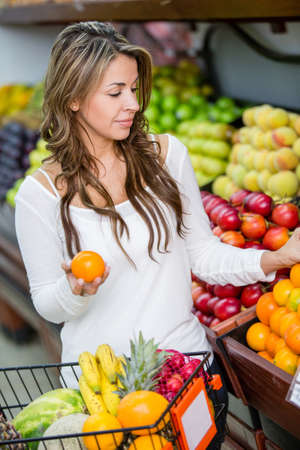 Casual woman shopping for groceries at the market Stock Photo - 16711098