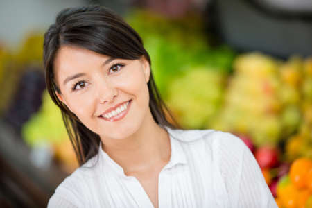 Happy woman at the local market smiling Stock Photo - 16711139