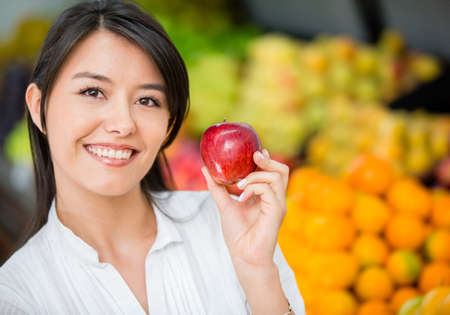 Woman buying organic apples at the supermarket Stock Photo - 16711100