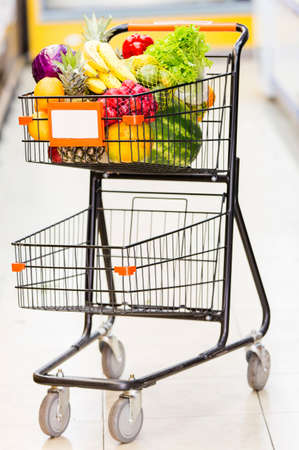 Shopping trolley full of fresh fruits and vegetables Stock Photo - 16801694