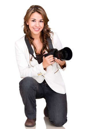 photographer: Female photographer holding a professional camera - isolated over white