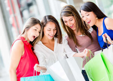 shoppers: Group of female shoppers looking very excited with their purhcases Stock Photo