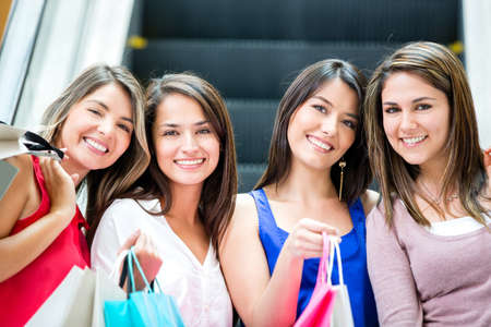 Beautiful girls shopping at the mall looking happy photo