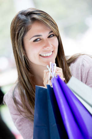 Beautiful shopping woman looking very happy with her purchases Stock Photo - 16763328