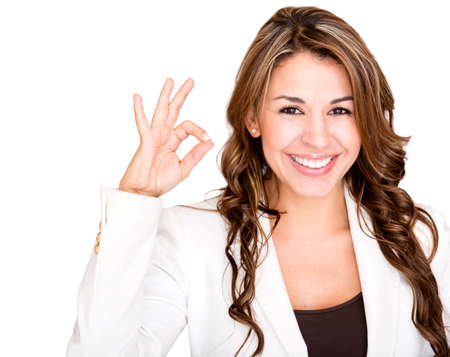 satisfactory: Happy businesswoman making an ok sign - isolated over a white background