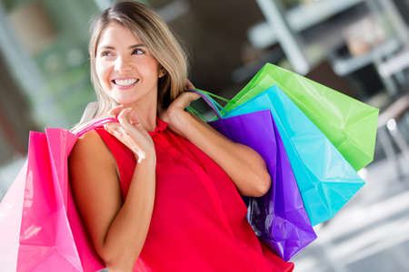 Pensive female shopper at the shopping center Stock Photo - 16848465