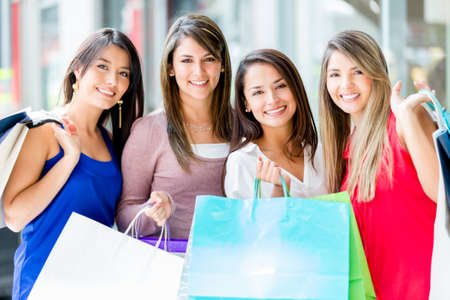 Group of women shopping at the mall looking happy Stock Photo - 16848474