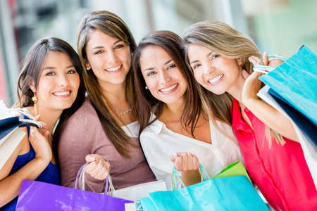 Group of beautiful female shoppers looking very happy Stock Photo - 16848444