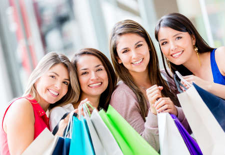 Group of beautiful shopping women holding bags Stock Photo - 16848469