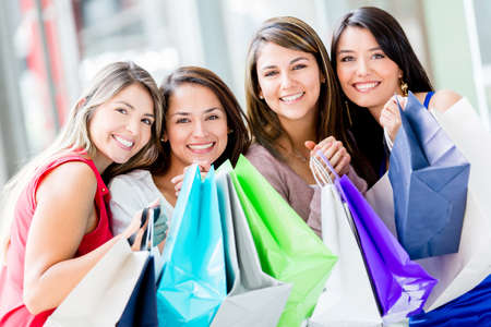Happy group of shopping women holding bags Stock Photo - 16848440