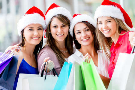 Happy group of women Christmas shopping at the mall photo