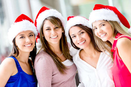 Group of happy Christmas women wearing Santas hat Stock Photo - 16848472