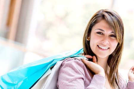 Shopping woman smiling and looking very happy Stock Photo - 16848437