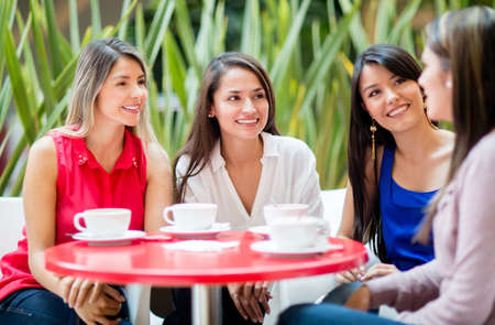 Group of women talking over a cup of coffee photo